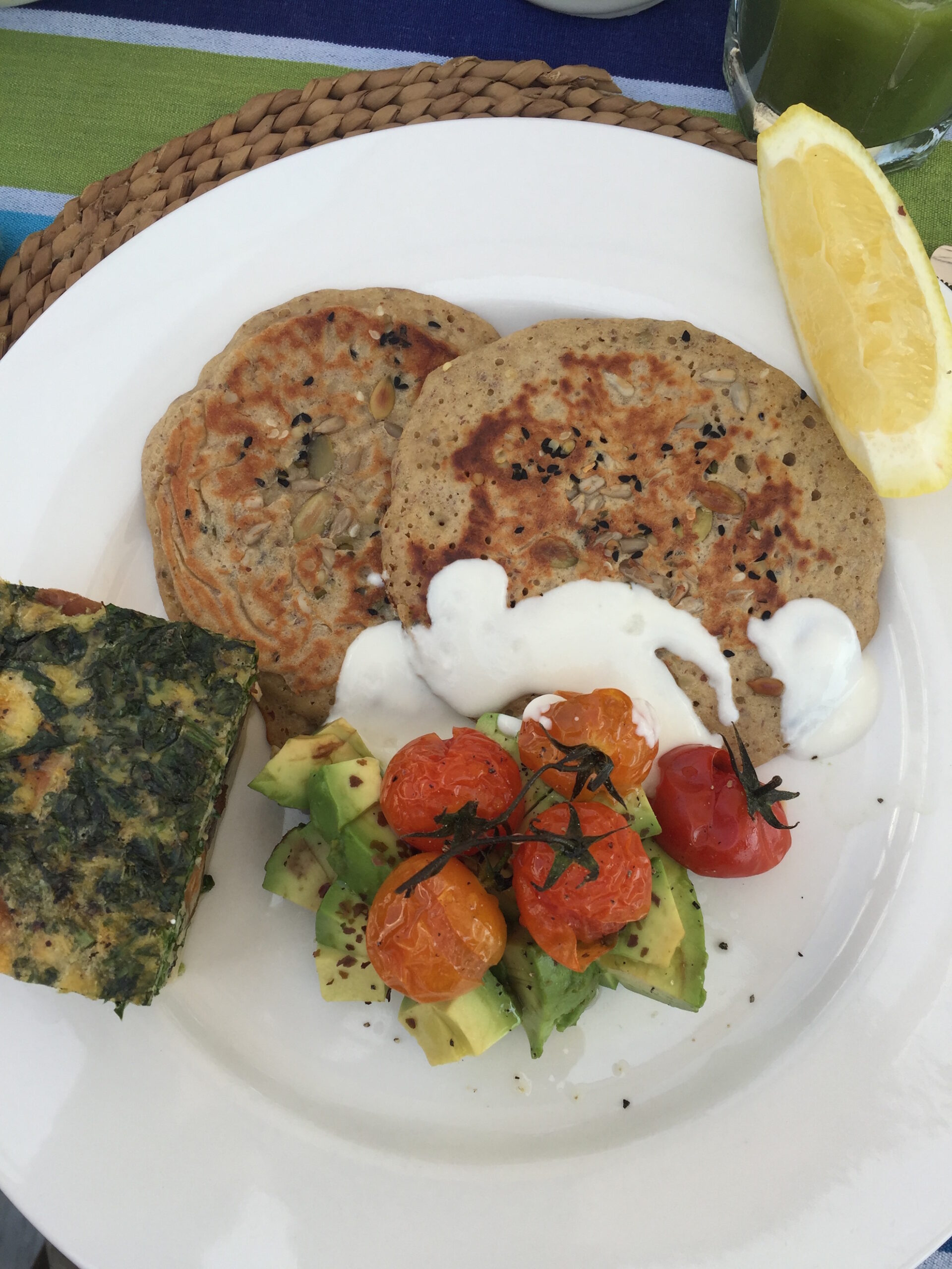 Ben Horne's pancakes with an avocado and tomato salad on the side